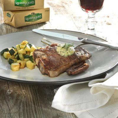 Grilled spring lamb cutlets with anchovy, olive and caper butter served with buttered courgettes