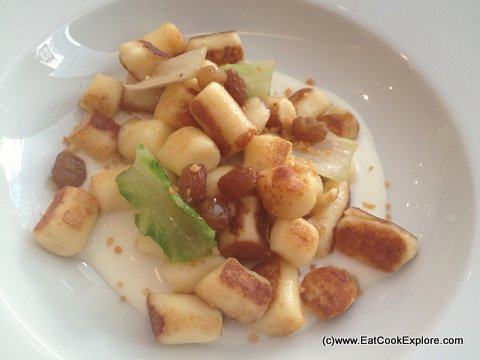 Roasted gnocchi with 18 month old Grana Padanao sauce, Romana lettuce and spicy sultanas