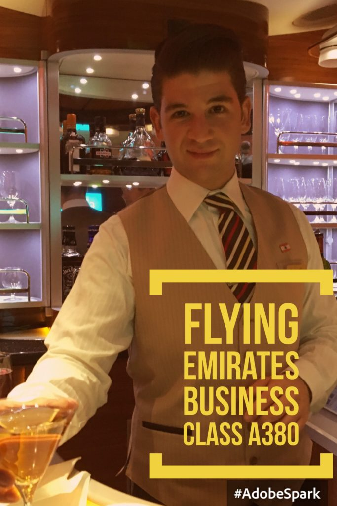 Flying Emirates Business Class A380 from London to Dubai. Here is Steward Cesar at the Sky Bar serving us cocktails. The bar is open up to 20 minutes before arrivals.