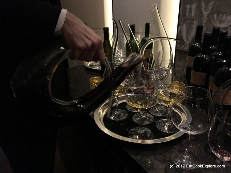 Pouring the Chairman's Reserve wine from Grace Estates