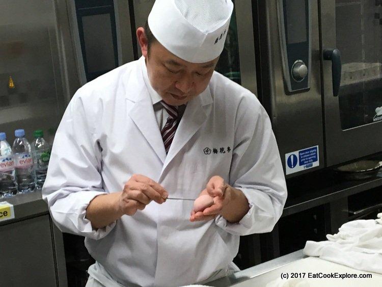 Wagashi making demonstration. Shaping the Sakura flower wagashi