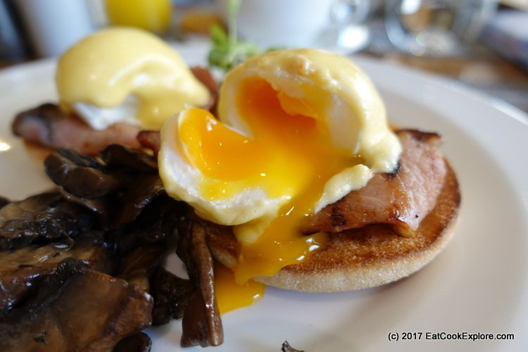 Perfectly poached eggs at Book and Brunch Lowndes Bar and Kitchen