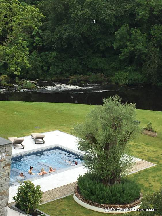 A view of the hot tubs and the river Galgorm Resort and Spa Northern Ireland