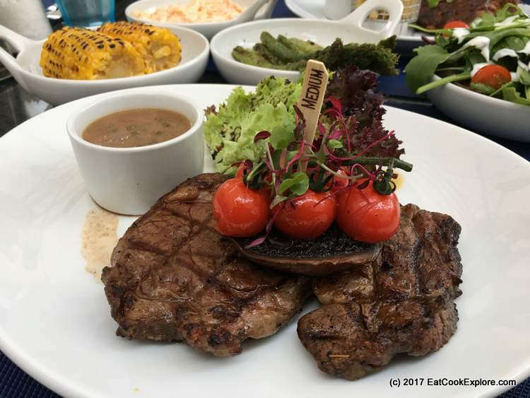 Rose County Rump Steak with grilled portobello mushroom and plum tomatoes