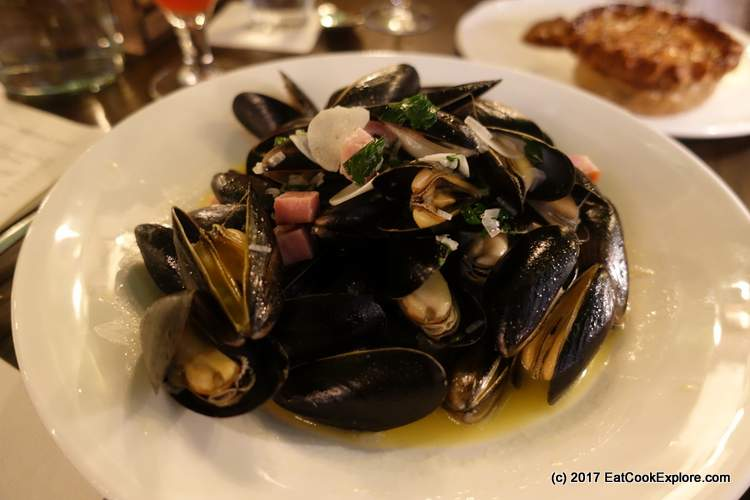 Mussels in a cider and smoked ham broth The Wigmore Tavern at The Langham Upper Regent Street