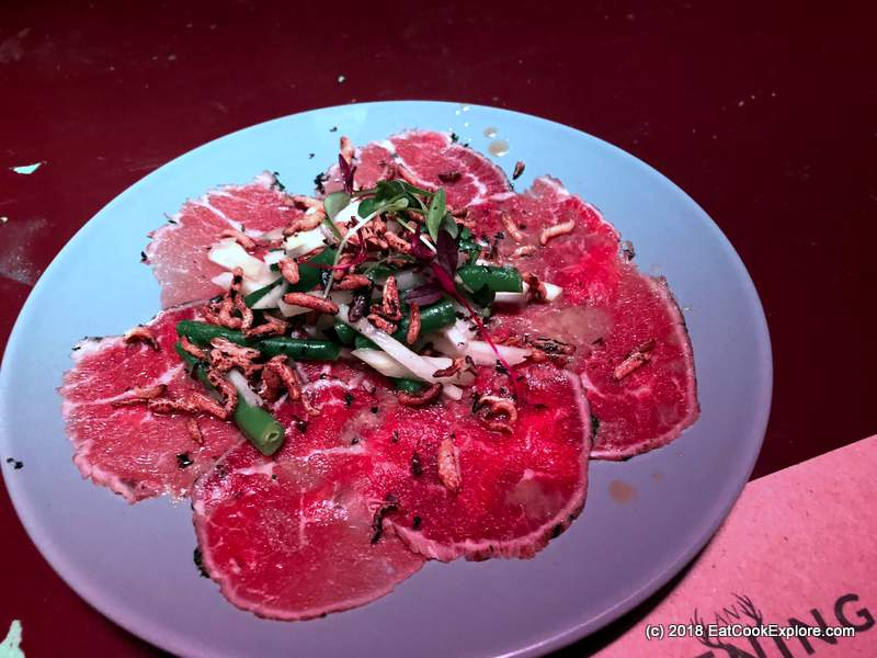 Seared carpaccio of dry aged tender beef, thai salad