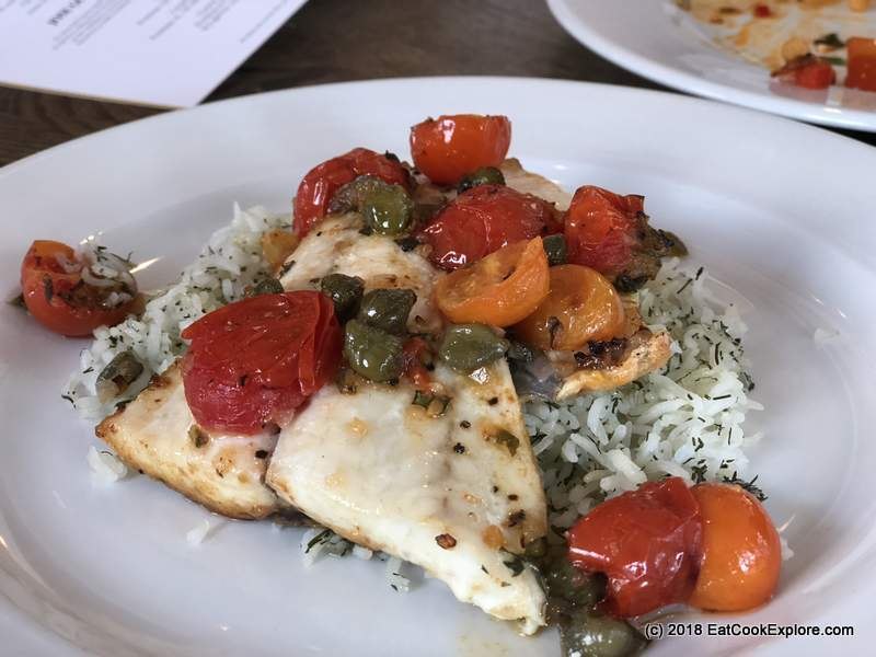 Baked seabream and cherry tomatoes with rice and dill