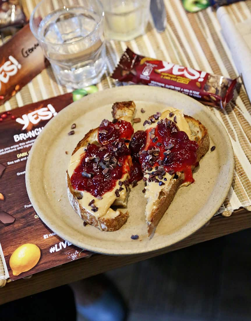 cranberry jam, peanut butter, cacao nibs on a toast