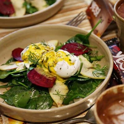poached eggs, mandolin beetroot, mandolin apple, spinach, hollandaise and roasted almonds