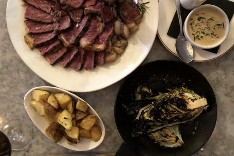 Grilled grass fed beef , charred hispi cabbage and potatoes