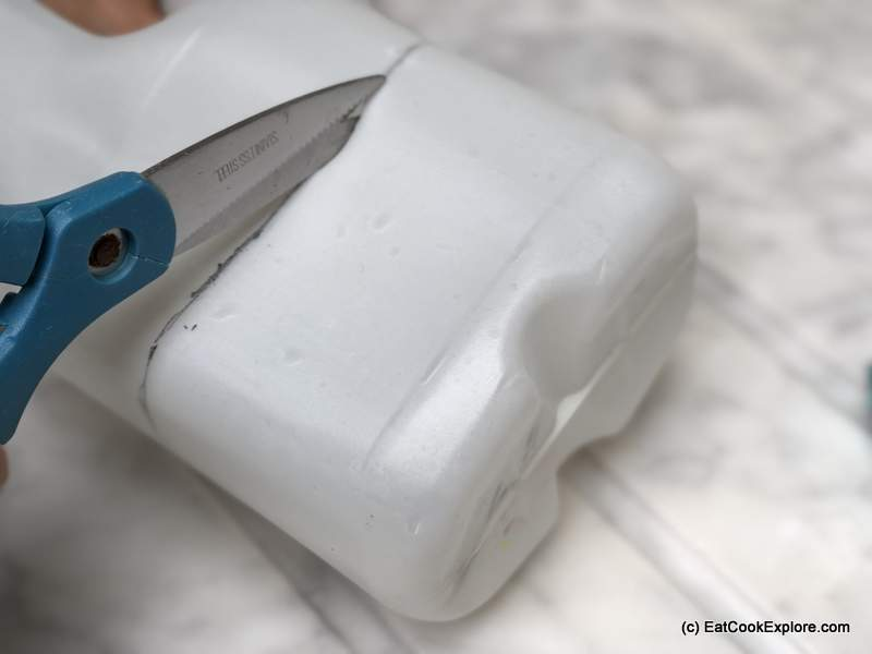 Then using a Stanley knife or sharp kitchen knife, cut a slit to start. You can then use a pair of kitchen scissors to cut along the line you drew.